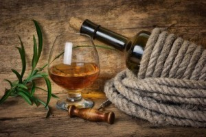 9278903-bottle-of-wine-wrapped-with-rope-on-the-background-of-the-old-wooden-planks